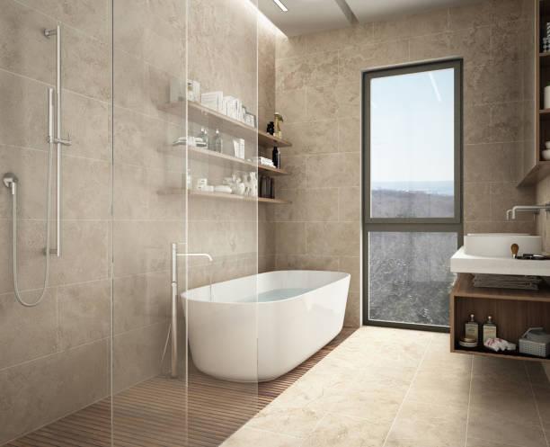 Modern limestone bathroom, bathtub and shower, shelves with bottles, big panoramic window stock photo