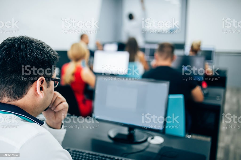 Modern listen to lectures stock photo