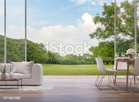 istock Modern living and dining room with green garden view 3d render 1071647290