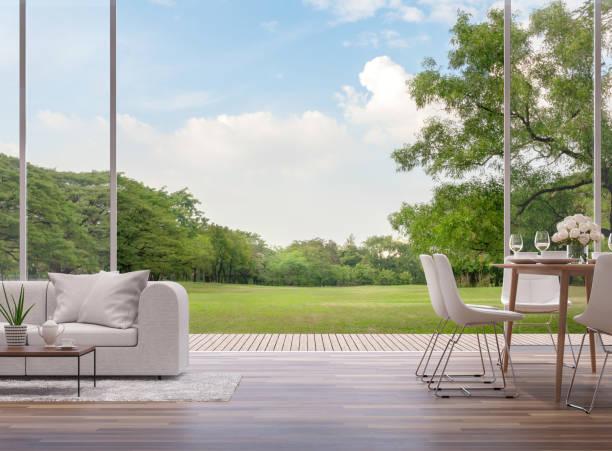 moderne wohn- und esszimmer mit blick auf den grünen garten 3d render - terrasse grundstück stock-fotos und bilder