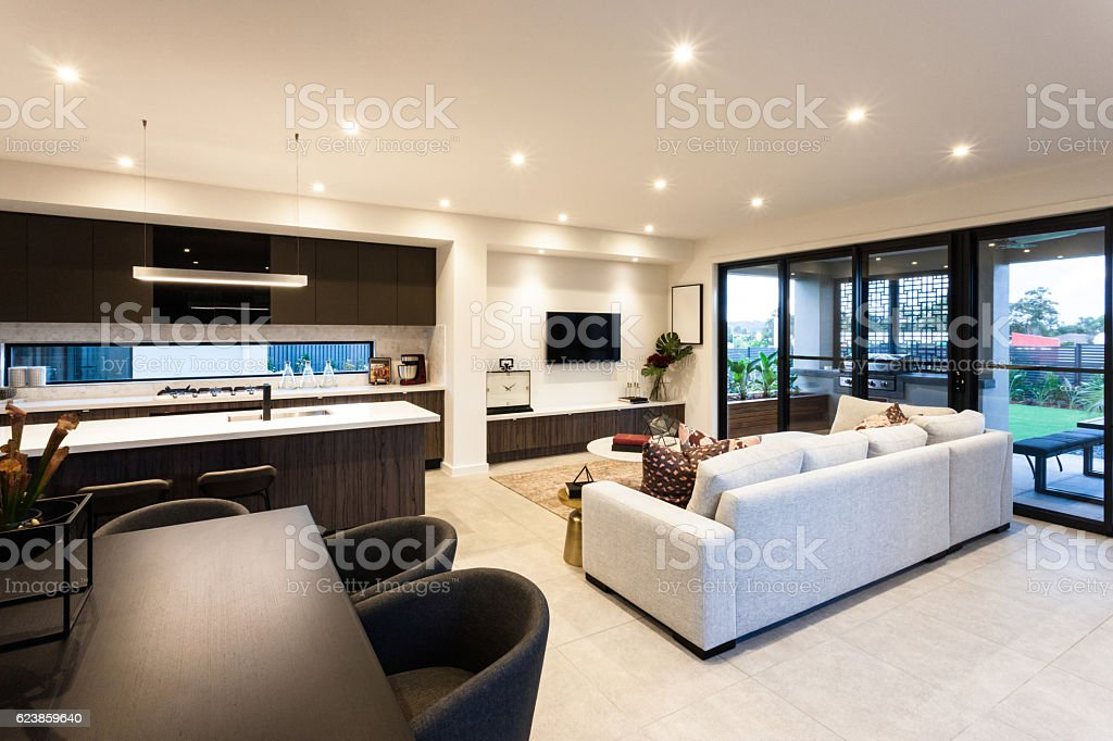 Modern Living Room And Dining Area Beside Patio Entrance Lizenzfreies Stock Foto