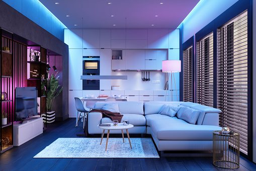 Modern Living Room And Open Plan Kitchen At Night With Neon Lights.
