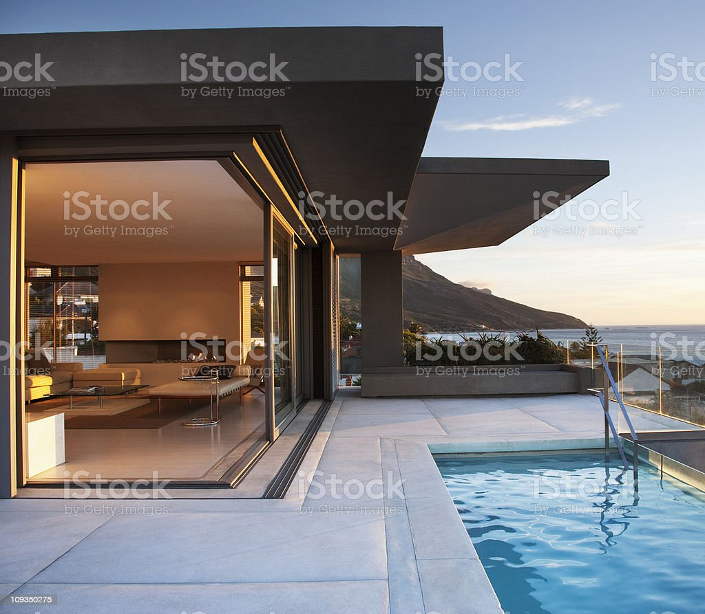 Modern living room and patio next to swimming pool stock photo