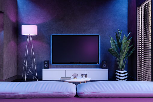Modern Living Room And Television Set At Night With Neon Lights