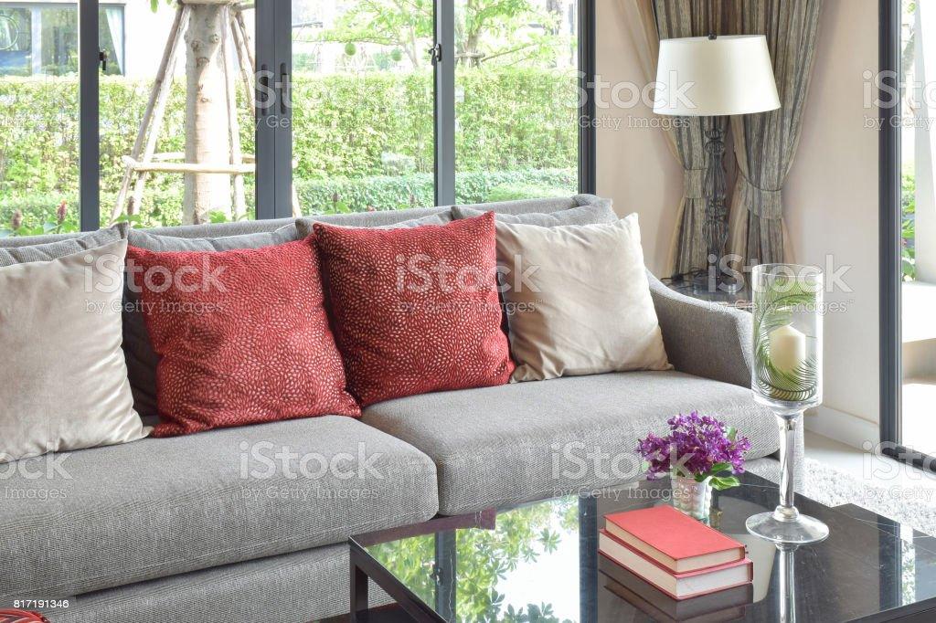 Modern Living Room Design With Red Pillows On Sofa And Decorative