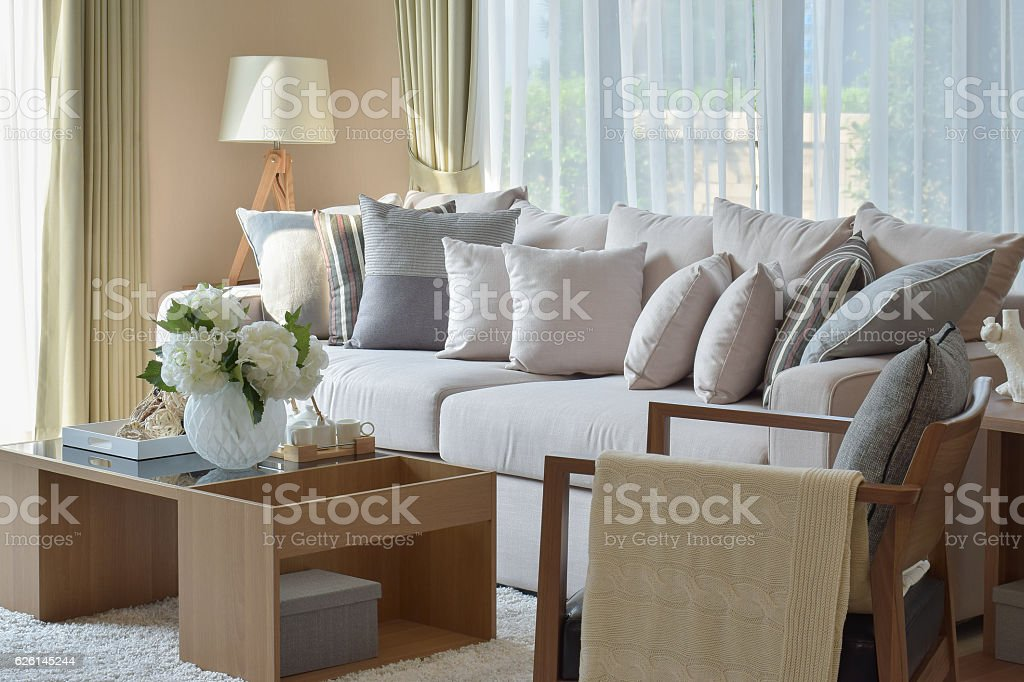 modern living room design with sofa and wooden lamp stock photo