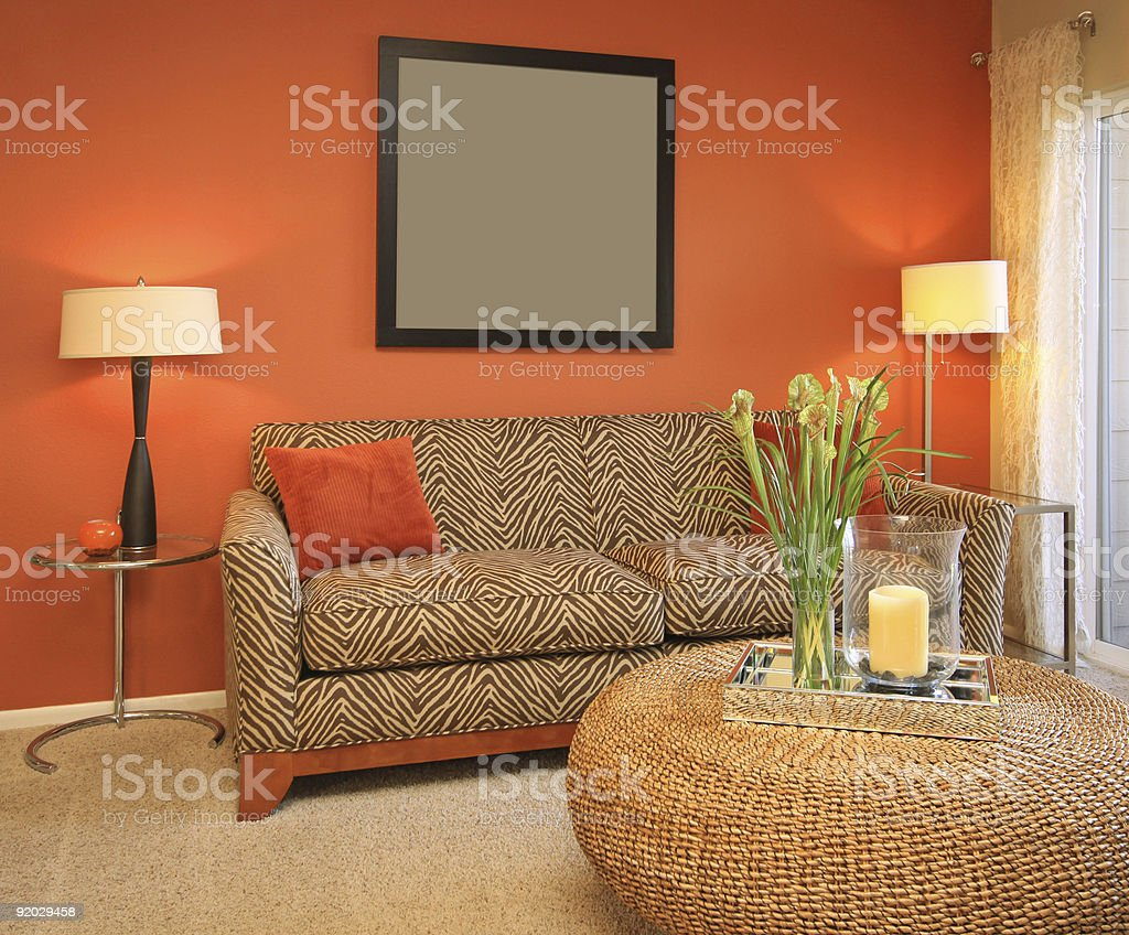 Modern living room furniture, placed before an orange wall royalty-free stock photo