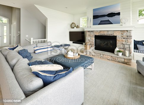+++ NOTE TO INSPECTOR +++ The framed photo artwork on the wall is my work and is currently in the iStock collection. See Property Release +++  A contemporary living room with fireplace and TV in a modern home.