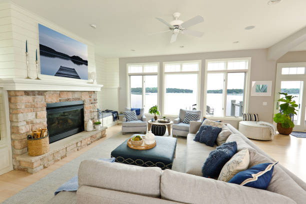 Modern Living Room Home Interior Design with fireplace and Television +++NOTE TO INSPECTOR+++ All photo artwork on wall are photo taken by me and is currently in iStock collection.  A contemporary luxury living room with fireplace in a modern waterfront home. promenade stock pictures, royalty-free photos & images