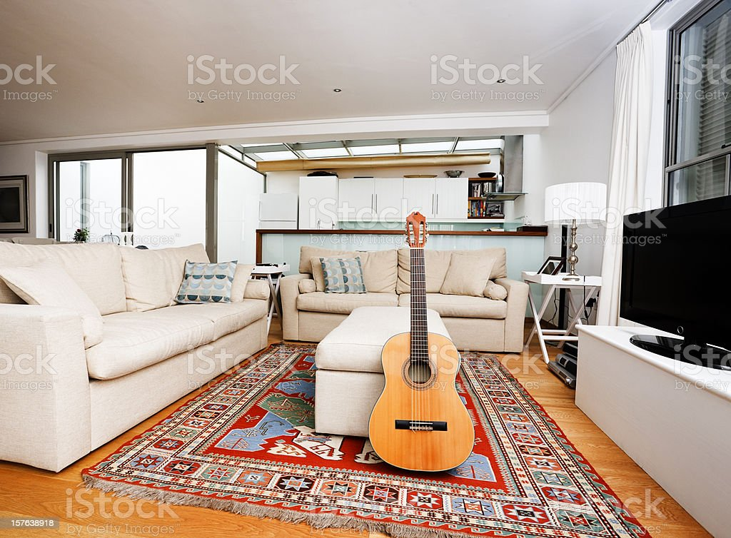 Modern living room interior with classic acoustic guitar stock photo