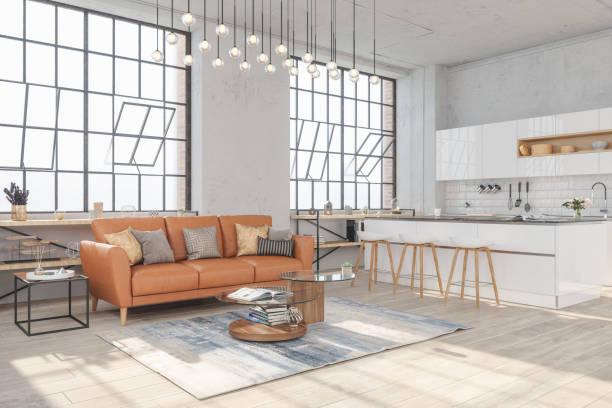 moderne woonkamer interieur met hardhouten vloeren en uitzicht op de keuken in new luxury home - loft stockfoto's en -beelden