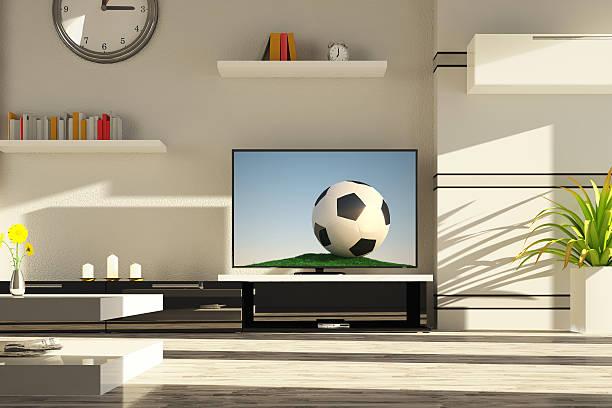 moderne wohnzimmer - fußball themenzimmer stock-fotos und bilder
