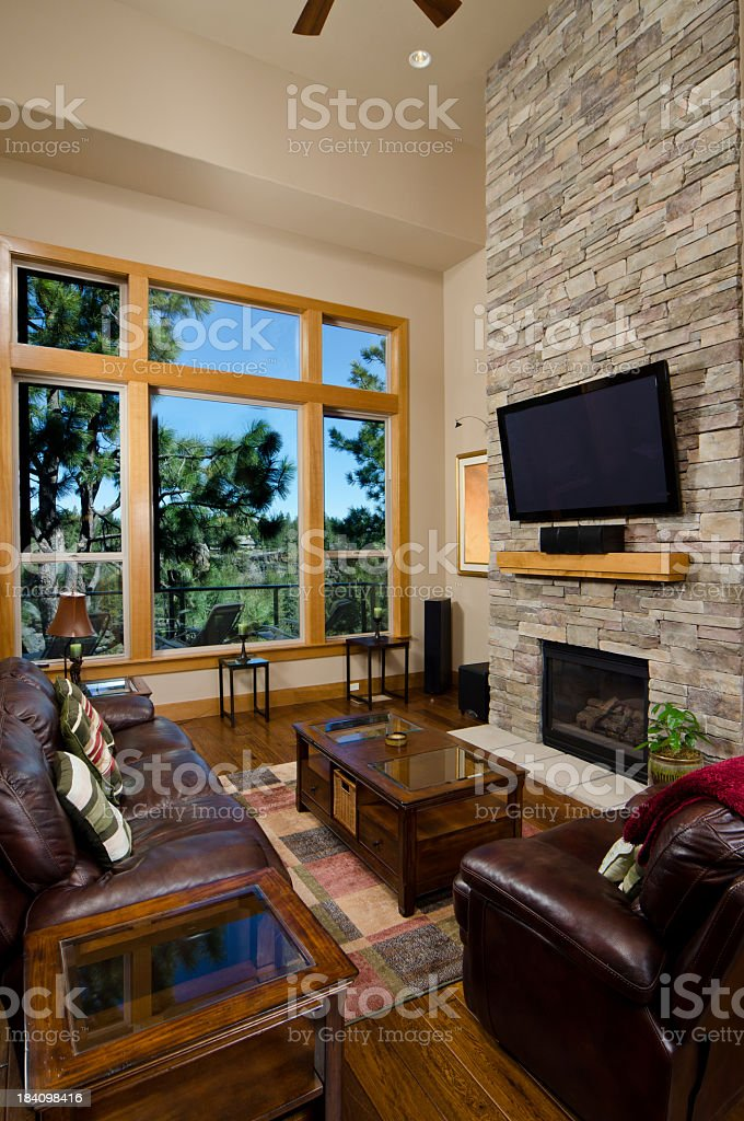 Modern living room set with brick wall and fireplace royalty-free stock photo