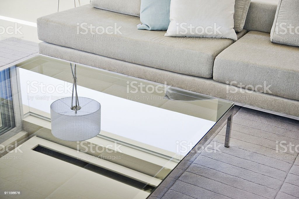 Modern living room, sofa and coffee table stock photo
