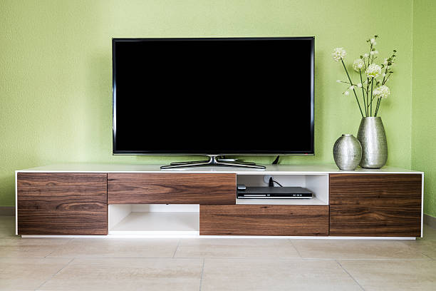modern living room with 55 inch tv and accessories - flat screen stock photos and pictures