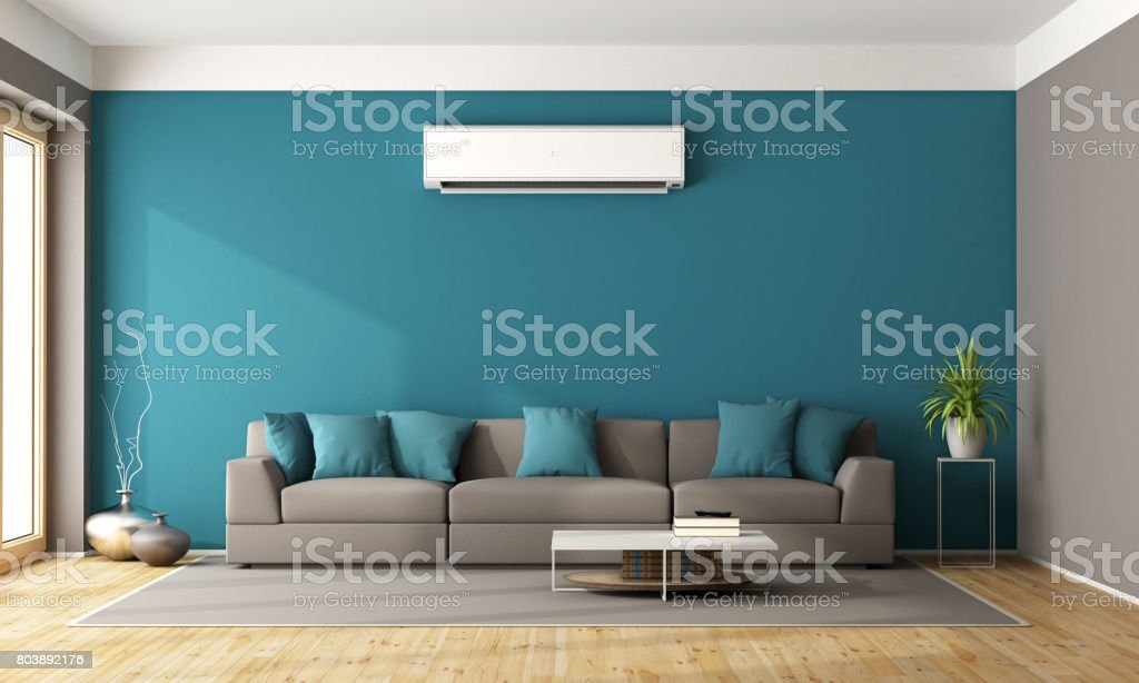 Modern living room with air conditioner стоковое фото