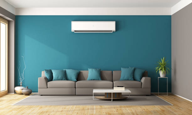 Modern living room with air conditioner stock photo