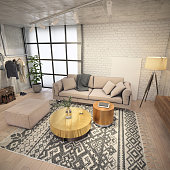 Modern studio living room loft with clothes rack on the wall, large window, art deco coffee table made of gold and bronze.