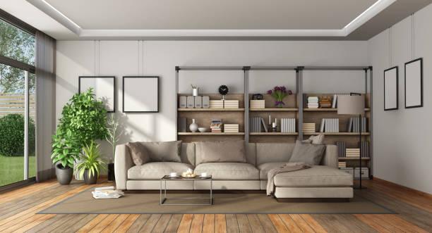 modernes wohnzimmer mit bücherregal und sofa - couchtisch metall stock-fotos und bilder