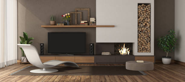 Modern living room with fireplace and tv set stock photo