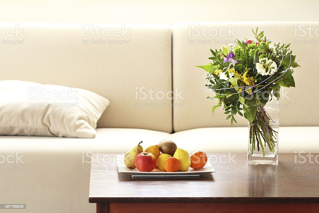 Modern living room with flower vase and fruit tray stock photo