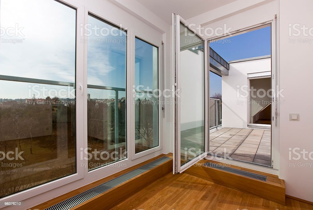 Modern living room with French window view royalty-free stock photo
