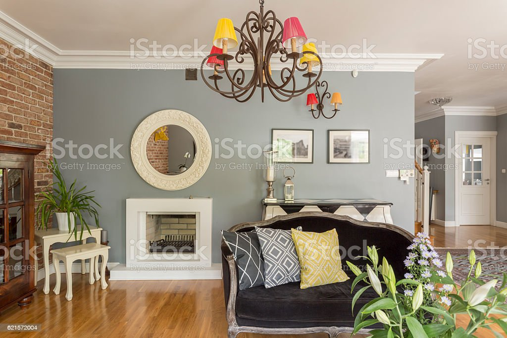 Modern living room with furnitures in different design styles photo libre de droits