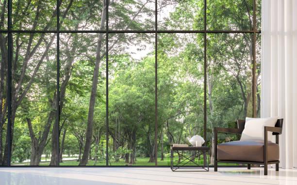 modernes wohnzimmer mit blick auf den garten 3d-rendering bild - große wohnzimmer stock-fotos und bilder