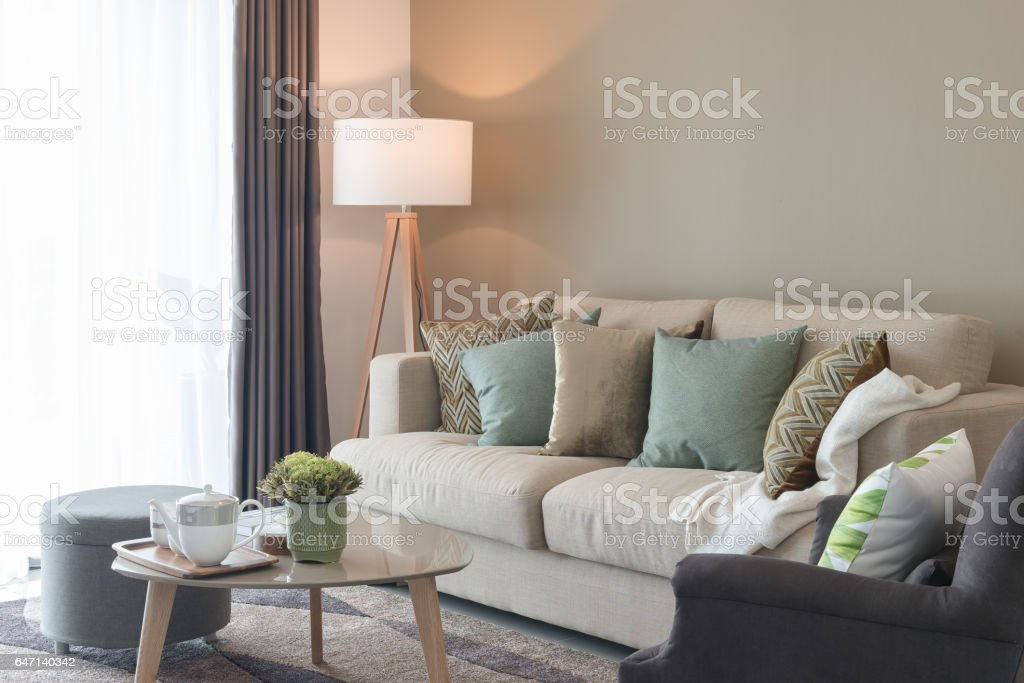 Modern Living Room With Green Pillows On Cozy Sofa And ...