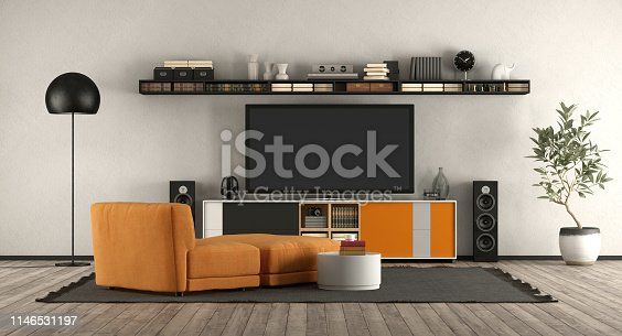Modern living room with home cinema equipment. orange armchair and sideboard - 3d rendering the room does not exist in reality, Property model is not necessary