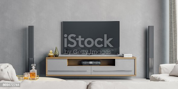 Interior of a contemporary minimalist living room with home entertainment system.