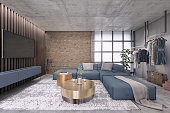 Modern living room with large TV on the wall, minimalist sofa, decorative vintage carpet, art deco , clothes hanger, coffee table, brick wall and wooden panels behind tv
