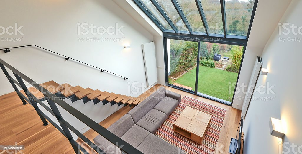 Modern living room with large windows stock photo