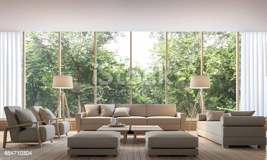 istock Modern living room with nature view 3d rendering Image 654710304