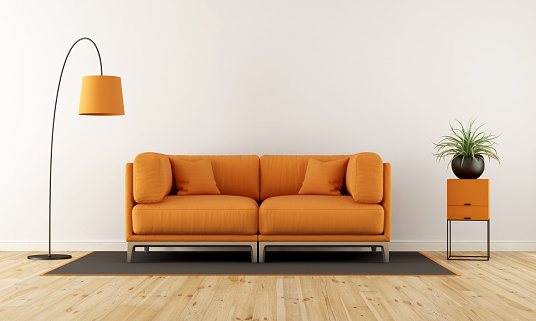 Modern living room with white wall, orange couch and floor lamp - 3d rendering