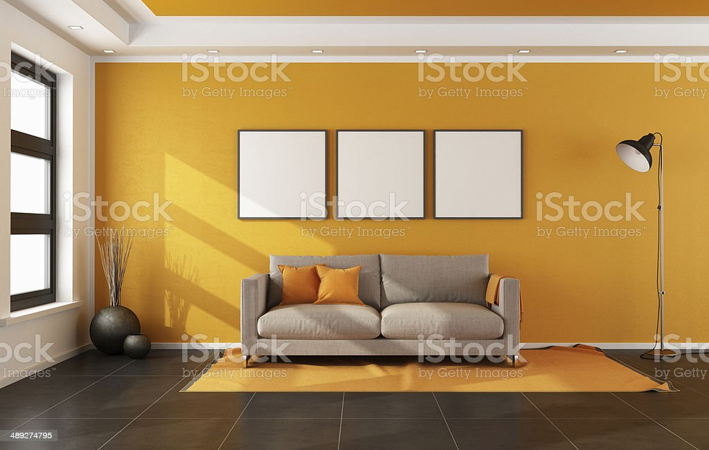Modern living room with orange wall stock photo