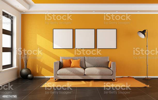 Modern Living Room With Orange Wall Stock Photo Download Image Now Istock