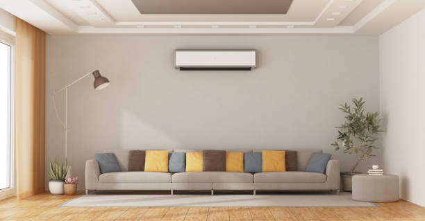 Modern living room with sofa and air conditioner stock photo