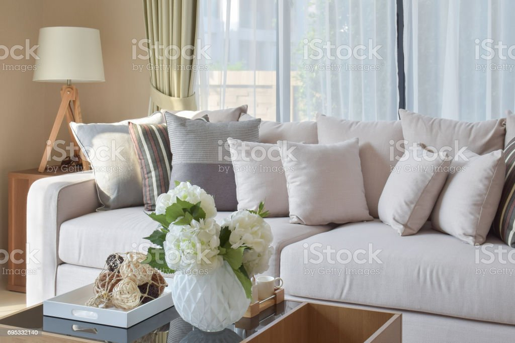 modern living room with sofa and wooden lamp at home stock photo
