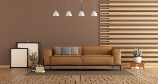 Modern Living room with sofa and wooden paneling stock photo