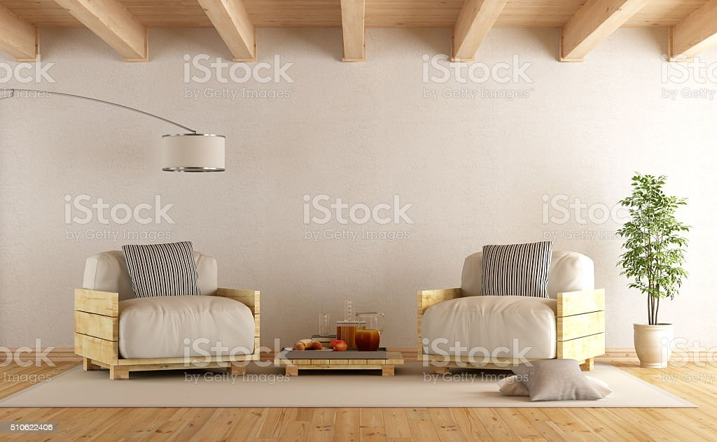 Modern living room with two pallet armchair stock photo