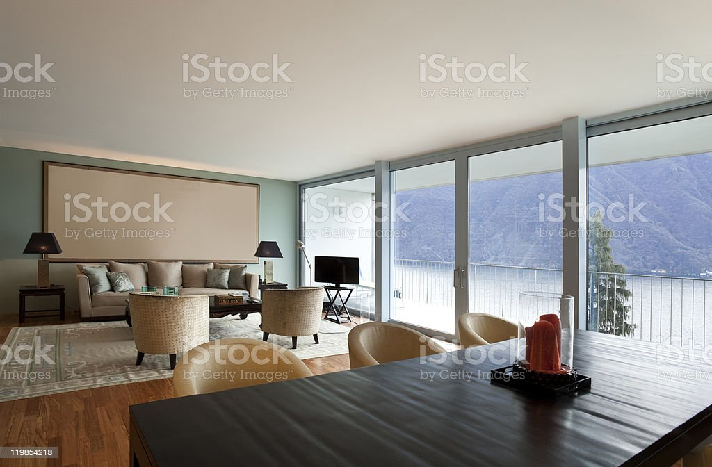 Modern living room with view of lake royalty-free stock photo