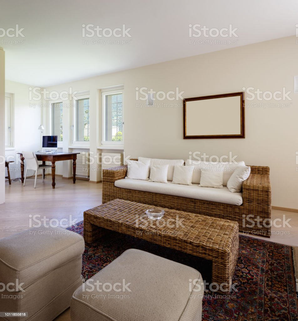 Modern living room with wicker furniture stock image