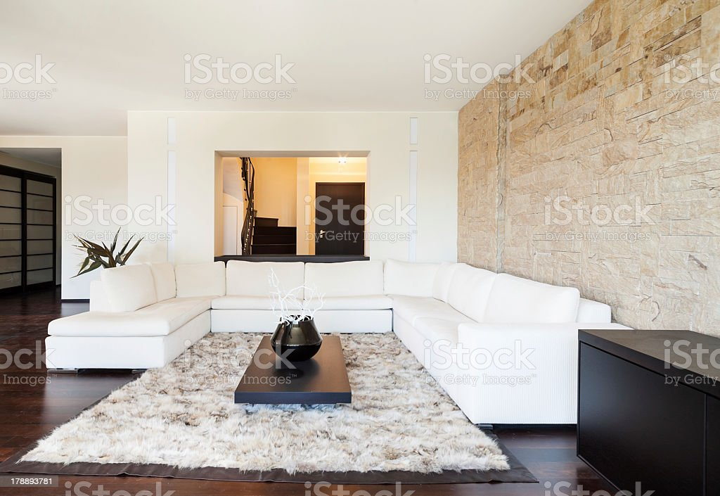Marvelous A Modern Living Space That Has A Big White Couch And Carpet Pdpeps Interior Chair Design Pdpepsorg