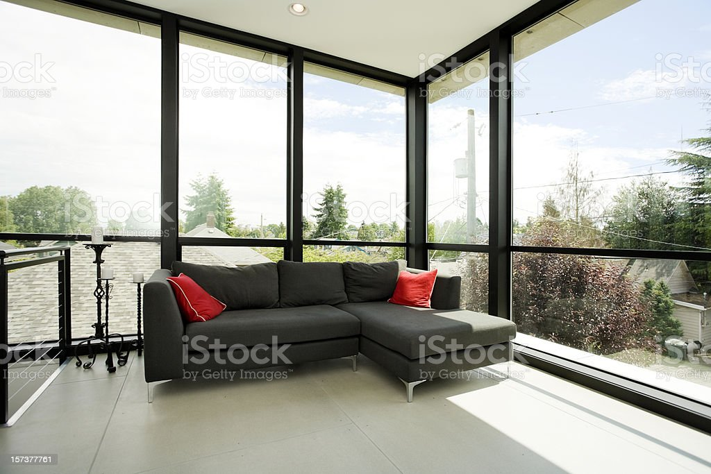 Modern living space with a black sofa royalty-free stock photo