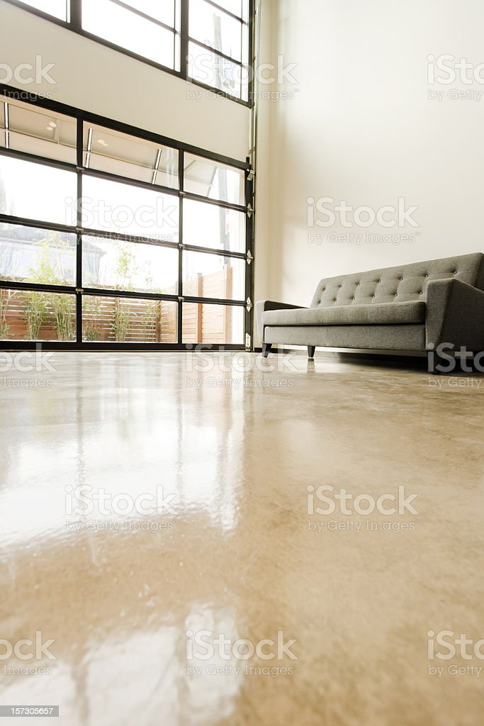 Modern Living Space with Polished Concrete Floor stock photo