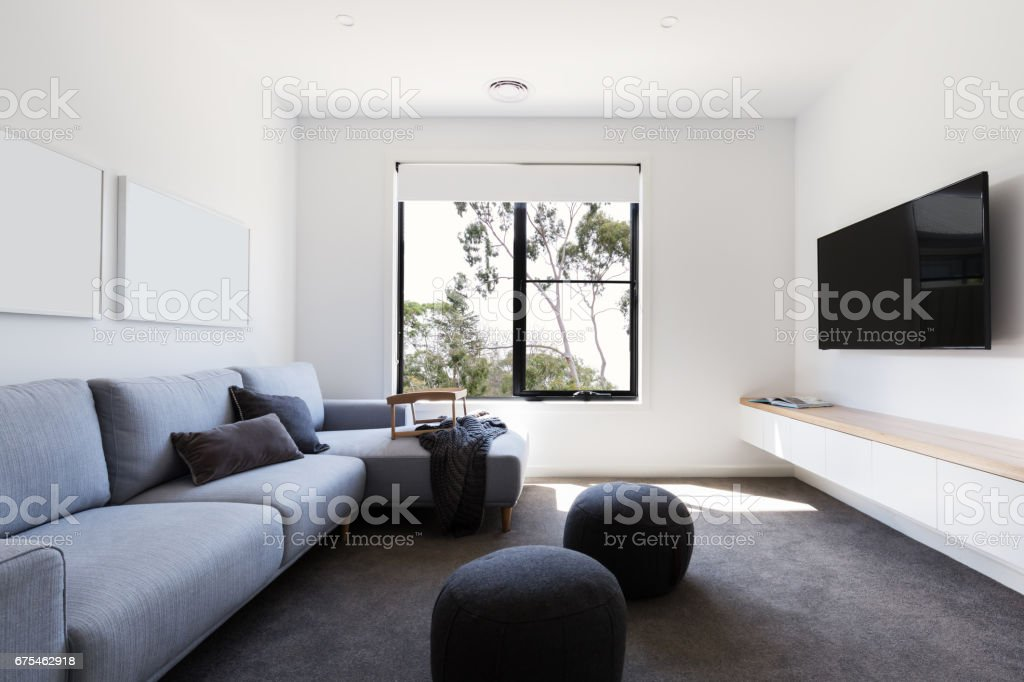 Modern living tv room in a contemporary home stock photo