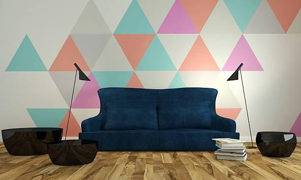 modern living-room interior with blue couch near colorful wall. - triangolo forma bidimensionale foto e immagini stock