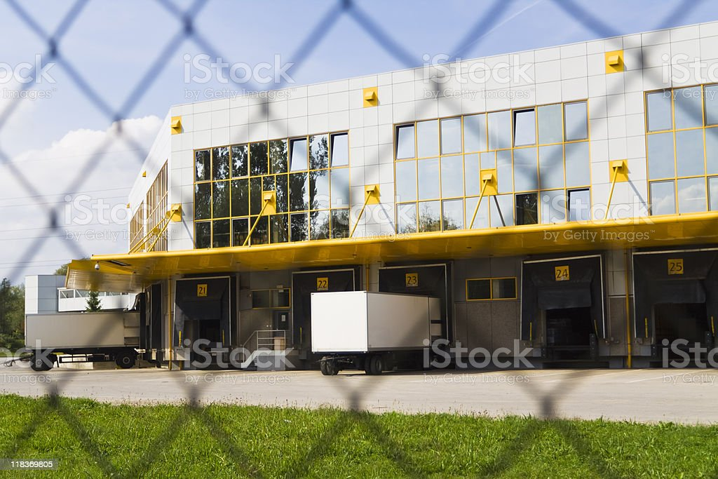 Modern loading docks as seen through a fence stock photo