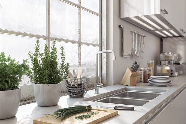 Modern Loft Kitchen Detailed shot of kitchen area inside a modern loft. penthouse stock pictures, royalty-free photos & images